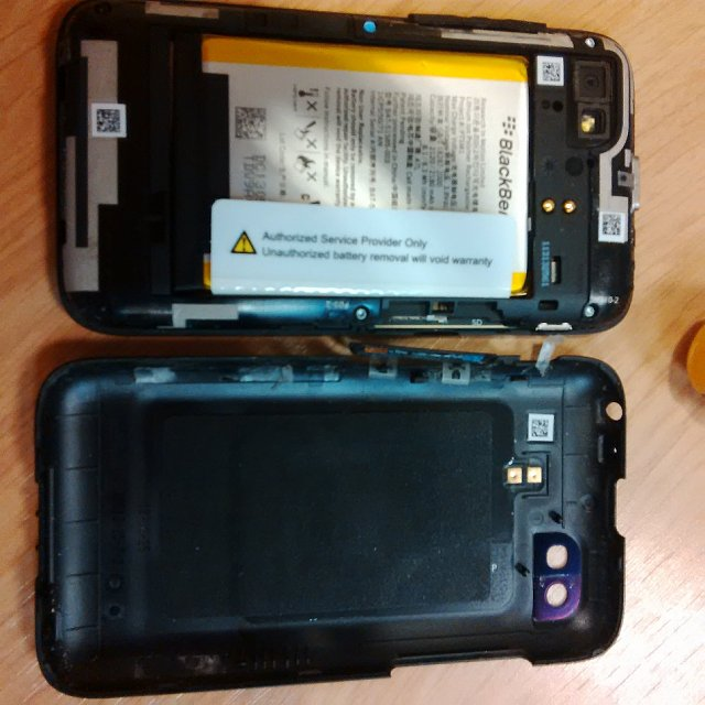 How do i open my q5 back cover?-img_00000337.jpg