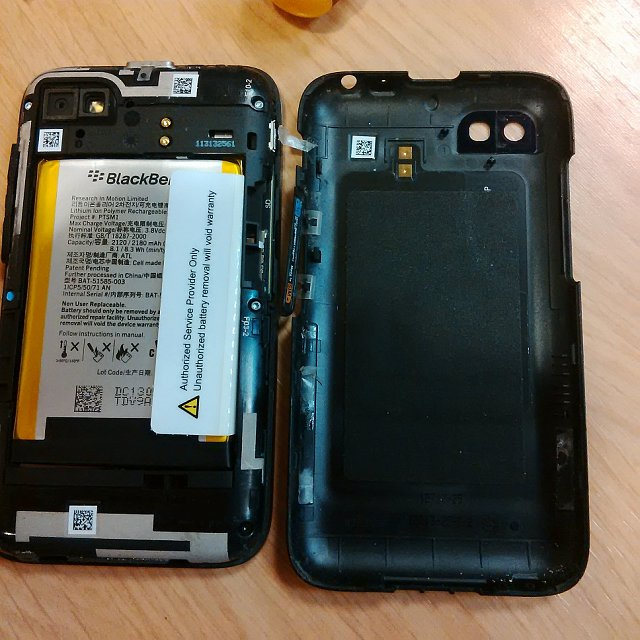 How do i open my q5 back cover?-img_00000338.jpg