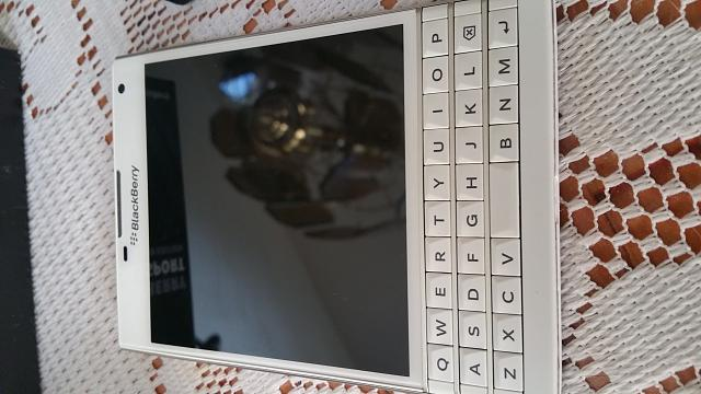 White BlackBerry Passport-uploadfromtaptalk1441726474823.jpg