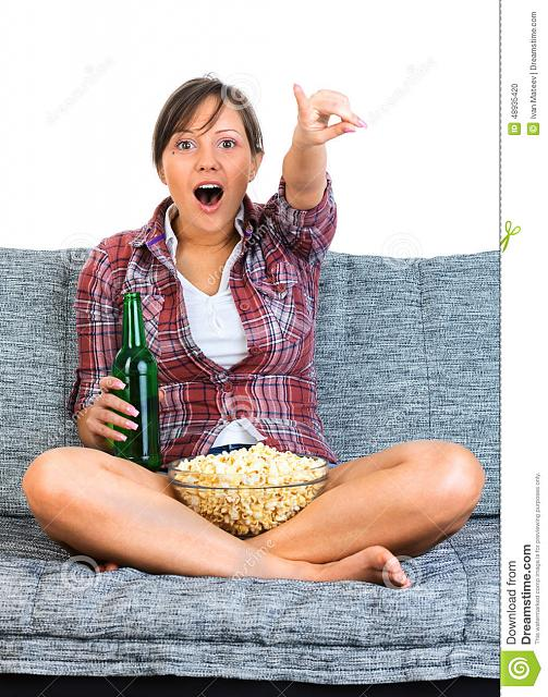 The CB 1M Challenge-young-woman-watching-football-eating-popcorn-drinking-beer-front-tv-sofa-isolated-white-backgrou.jpg